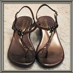 Lovely bronze sandals.